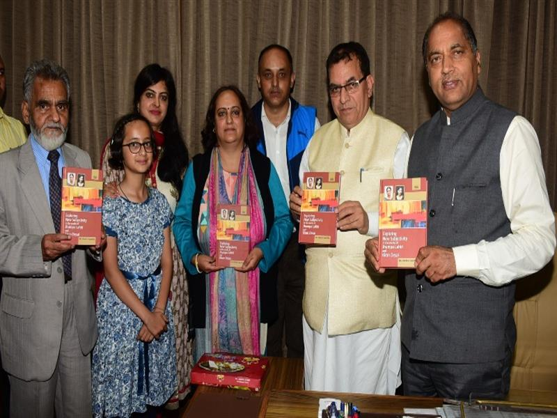 Chief Minister Shri Jai Ram Thaku releasing book of Dr. Vinita Sipahiya at Shimla.