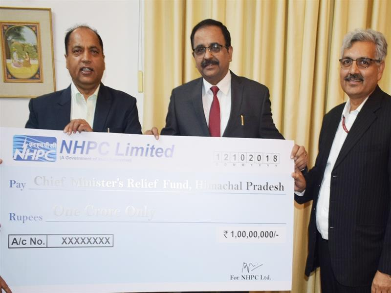 Chief Minister Shri Jai Ram Thakur being presented a cheque of Rs. One Crore by NHPC towards CM Relief Fund at Shimla on 12 October 2018.