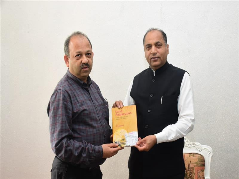 Chief Secretary Shri B.K Agarwal presenting book to Chief Minister Shri Jai Ram Thakur at Shimla on 15 July 2019.
