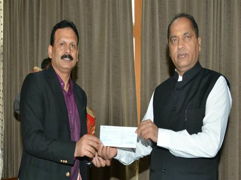 Chief Minister Jai Ram Thakur being presented a Cheque of Rs 51 lakh by the Deputy Commissioner Una Cum Chairman Chintpurni Temple Trust Shri Sandeep Kumar towards the CMRF at Shimla on 14 Aug 2019