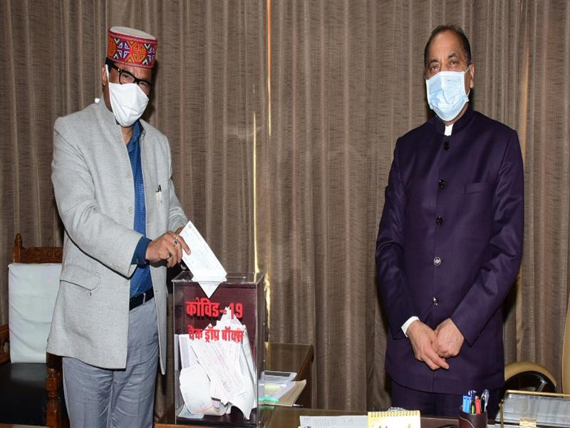 Chief Minister Shri Jai Ram Thakur  being presented a cheque of Rs. 1,73000  by Forest and Transport Minister Govind Singh Thakur at Shimla on 21 May 2020.