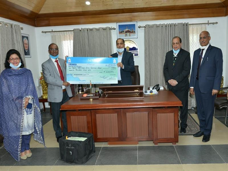 Chief Minister Shri Jai Ram Thakur  being presented a cheque of Rs Fourty Five Lakh by SJVN L  towards CM relief fund at Shimla on 22 May 2020.