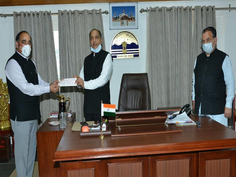Chief Minister Jai Ram Thakur being presented a cheque towards HP SDMA COVID-19 State Disaster Response Fund at Shimla on  23 May 2020.