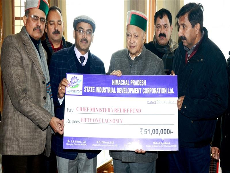 Chief Minister Sh. Virbhadra Singh being presented a cheque of  Rs 51 lacs by Industries Minister Sh Mukesh Agnihotri on behalf of HPSIDC towards C M Relief fund at Shimla on 10 Jan 2017.